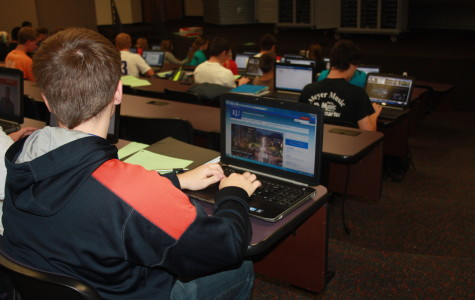 Tyler Lowes looks at KU's website in the ACT prep class.