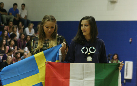 Emma Alander and Anna Maria Diana from Sweden and Italy hold their countires flags. They will be displayed in the commons all year.