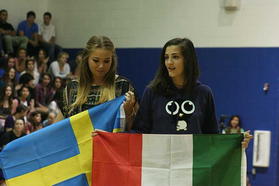 Emma+Alander+and+Anna+Maria+Diana+from+Sweden+and+Italy+hold+their+countires+flags.+They+will+be+displayed+in+the+commons+all+year.