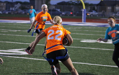 Senior Rachael Bovitz runs the football during the Powderpuff game. The seniors trumped the juniors 30-20.