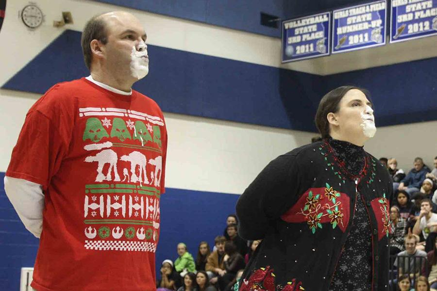 Teachers Mike Zegers and Deb Osborn chew bubble gum, each trying to blow the first bubble. Osborn won the competition.