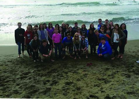 Group photo by beach