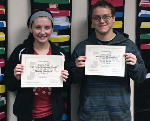 Seniors Shelby Simpson and Alex Cross show off their 2nd place certificates. Senior Ashley Collins also received an Honorable Mention at the contest.