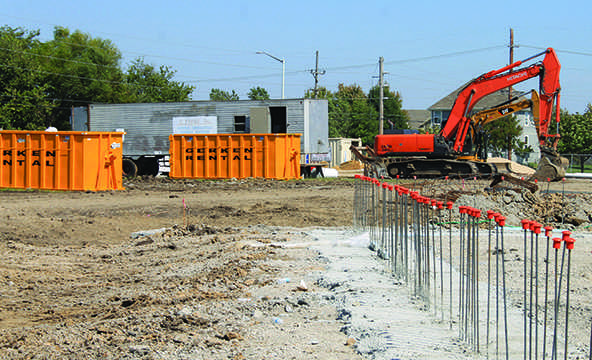 Bulldozers clear the way for the new space attached to the fine arts hallway. The addition will house 18 classrooms.