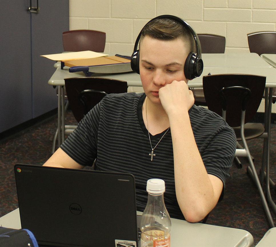 Senior Josh Bays works on an assignment.