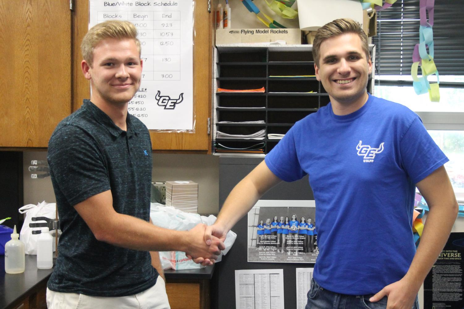 Senior Logan Green and Chemistry teacher Andrew Kipp shaking hands