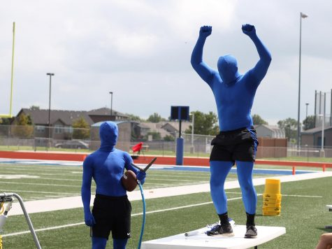 At the kickoff pep assembly before the first home football game, the blue men dance to get the student section pumped up. Pep assemblies making a comeback is a big impact to the social activities put on pause during Covid.